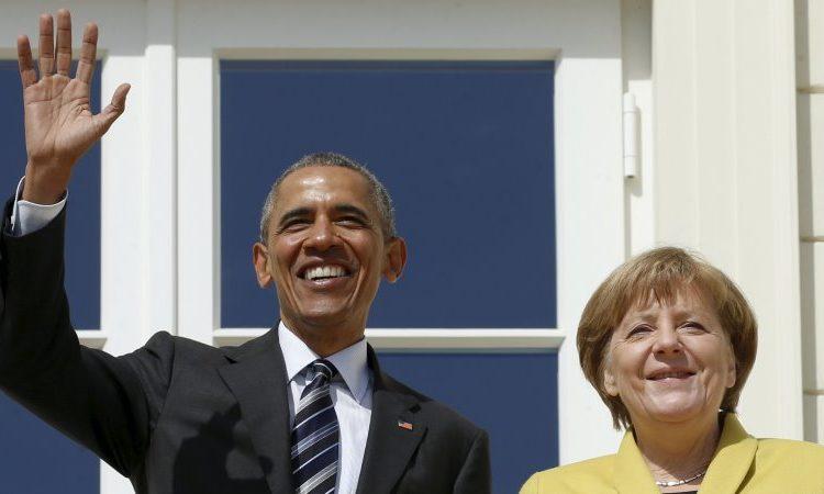 Presidenti Obama takohet me kancelaren gjermane Angela Merkel në Hanover, Gjermani. (Foto nga: Pool/Getty Images)