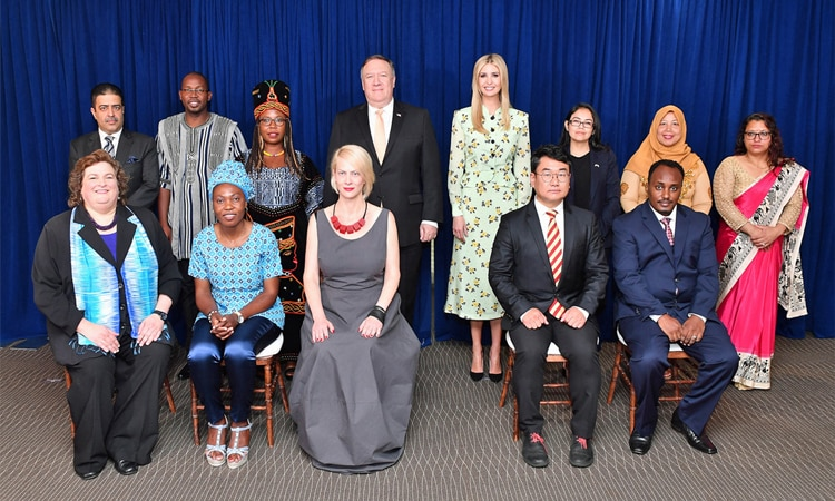 U.S. Secretary of State Mike Pompeo (center left), Advisor to the President Ivanka Trump (center right), and Acting Director of the Office to Monitor and Combat Trafficking in Persons Kari Johnstone (front far left) pose for a group photo with the 2018 'TIP Report Heroes' at the U.S. Department of State, on June 28, 2018. (State Department photo/ Public Domain)